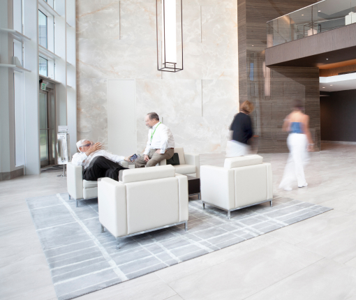 Lobby interior of 800 Waterford with business people conversing