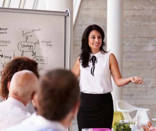 Business woman presenting in a meeting.